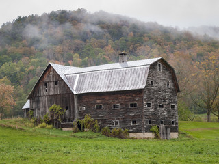 Old Vermont Barn: A large wooden clapboard barn near Tunbridge, Vermont in autumn