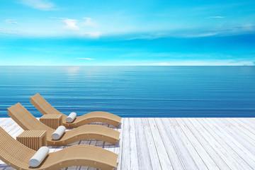 Beach lounge, sundeck over blue sea and sky, summer beach holiday vacation concept