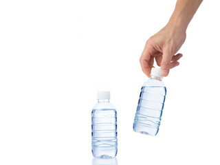 Male's hand grabs a bottle of water with another bottle of water