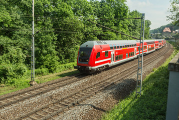 Red train is on the track in Saxony