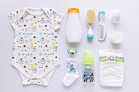 Top view of unisex newborn baby necessities.