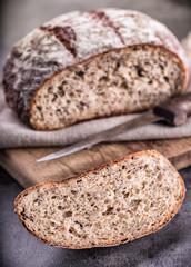 Bread. Fresh bread. Homemade traditional bread. Sliced bread crumbs knife and cumin.