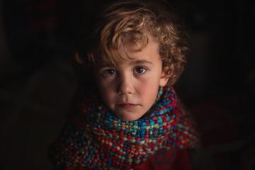 Portrait of boy wearing scarf