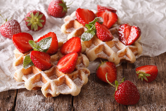 Beautiful sweet waffles with strawberries, powdered sugar. horizontal