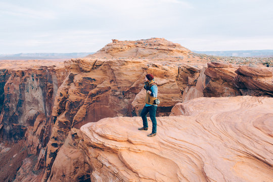 Man looking at view of sandstone mountains