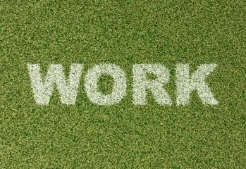 WORK - grass letters on football field