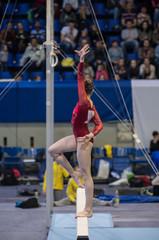 Gymnastics. Gymnast doing a exercise on the Balance Beam.
