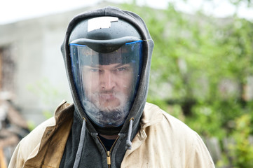Portrait of a man working in a protective helmet