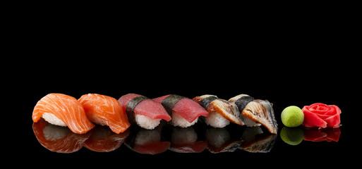 Sushi nigiri set over black background