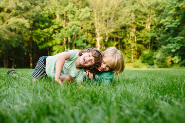 Two young brothers, fooling around, laughing, outdoors