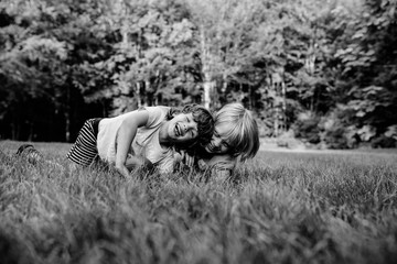 Two young brothers, fooling around, laughing, outdoors, black and white
