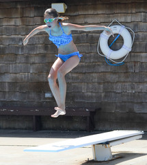 Girl Jumping on a Diving Board