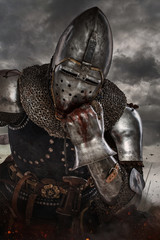 Thoughtful knight over dark clouds background.