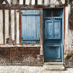 Blue door on tudor style building