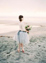 Bride dancing on beach