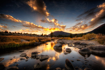 Rocky riverbed and mountain at sunset