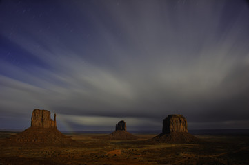 Rainbow over rock formation in monument valley