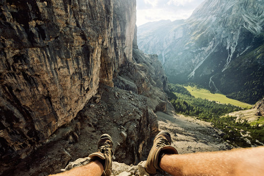 Hikers legs and elevated view for mountainside