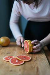 Woman slicing grapefruit