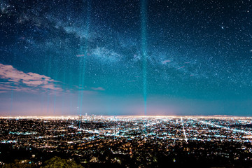 Beans of light in starry sky over los angeles