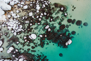 Aerial drone vie of rocks at lake Tahoe
