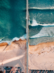 Aerial drone view of pier on coastline