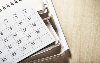 Office supply. With calendar.On desk.