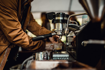 Barista preparing coffee with coffee machine