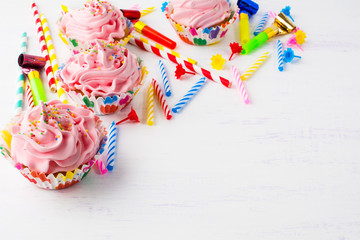 Birthday background with pink cupcakes