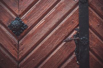 Part decorative old wooden door with textured pattern.