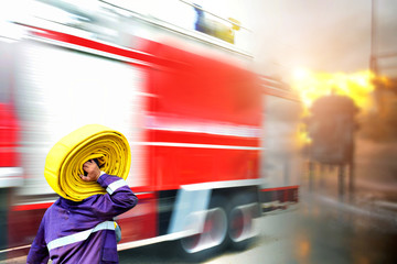Emergency rescue concept ,Fire fighter on oil and gas industry, successful firefighter at work , Fire suit for fighter with fire and suit for protect fire fighter, Security team when fire case.