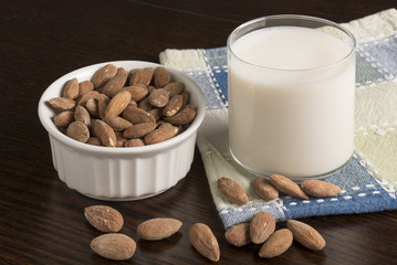 Almond Milk with almonds on table