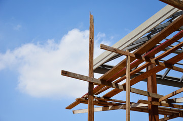 roof construction with sky background.