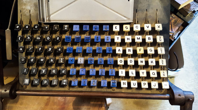 Vintage Linotype printing press keyboard used for hot metal typesetting and publishing.