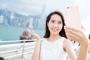 Woman taking self image at Victoria Harbor