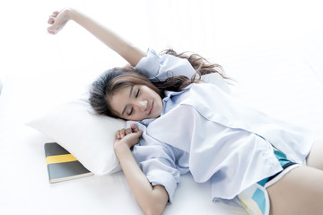 Young Asian Women wake up and Stretching
