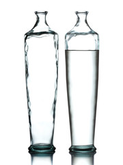 Empty and full water glass vase