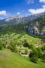 Panorama view of Lauterbrunnen with train going to the famous mountain Jungfraujoch