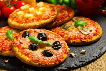 Mix of mini pizzas on a stone try