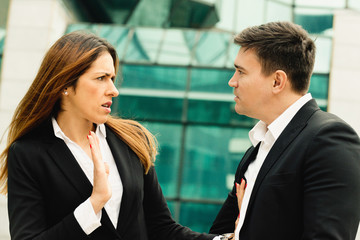 Sexual harassment at work. Business woman in conflict with her colleague