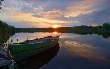 fisherman boat at sunset time