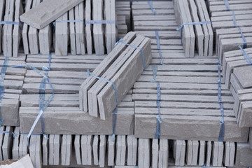pile of gray stone tiles prepare for install