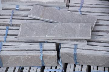 pile of gray stone tiles prepare for install