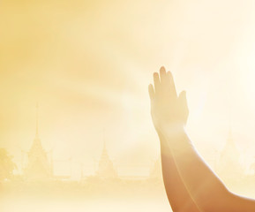 Leinwandbilder - Respecting and praying hands on the temple background