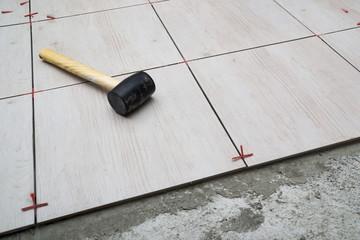 Home renovation. Installing ceramic floor tile