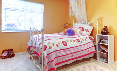 Orange girl teenager kids bedroom with toys, white bed frame and