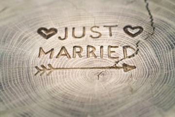 Woodcarving. Newlyweds, Just married, inscription on the wedding