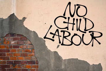 No Child Labour - Handwritten graffiti sprayed on the wall, anarchist aesthetics. Appeal to fight against exploitation of children's work