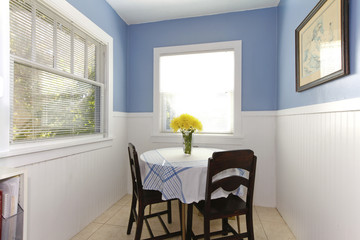 Bright small dining room with carpet windows, table and chairs