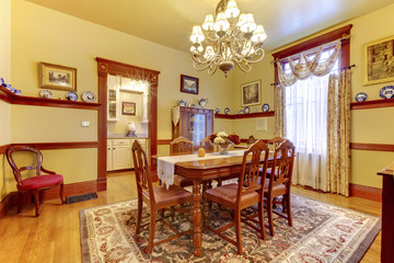 Luxurious dining room with wood table chair set, chandelier and